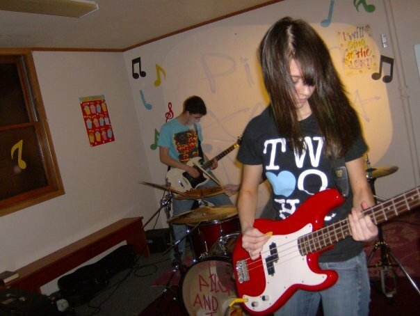 Photo of Elise Fajen playing Bass in her high school band.