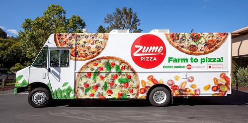 Pizza startup, Zume Pizza's trucks cook on the go for a true hot out of the oven experience.