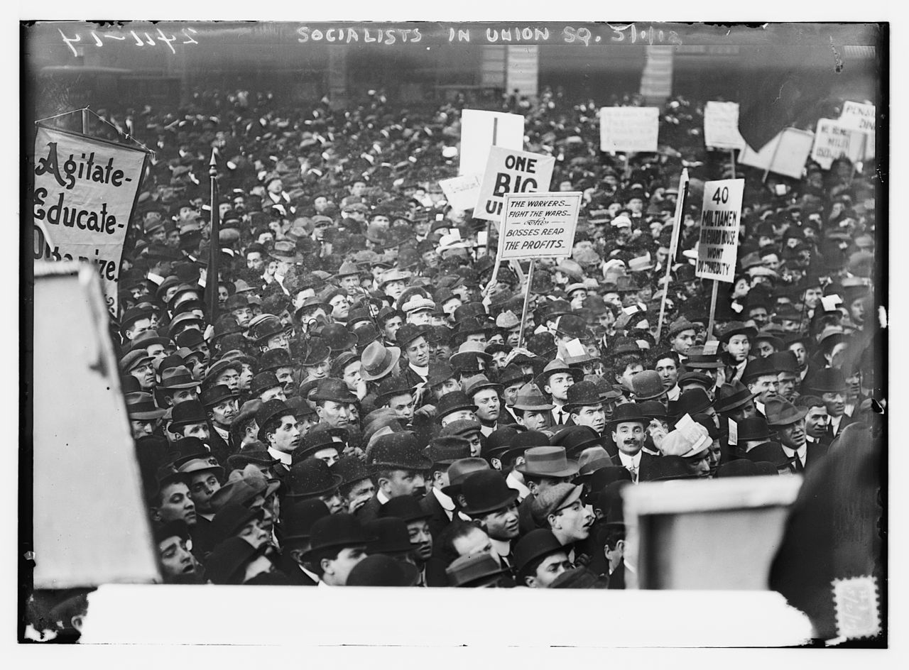 Image of workers demonstrating for rights illustrates article on payroll and payroll taxes for small businesses.