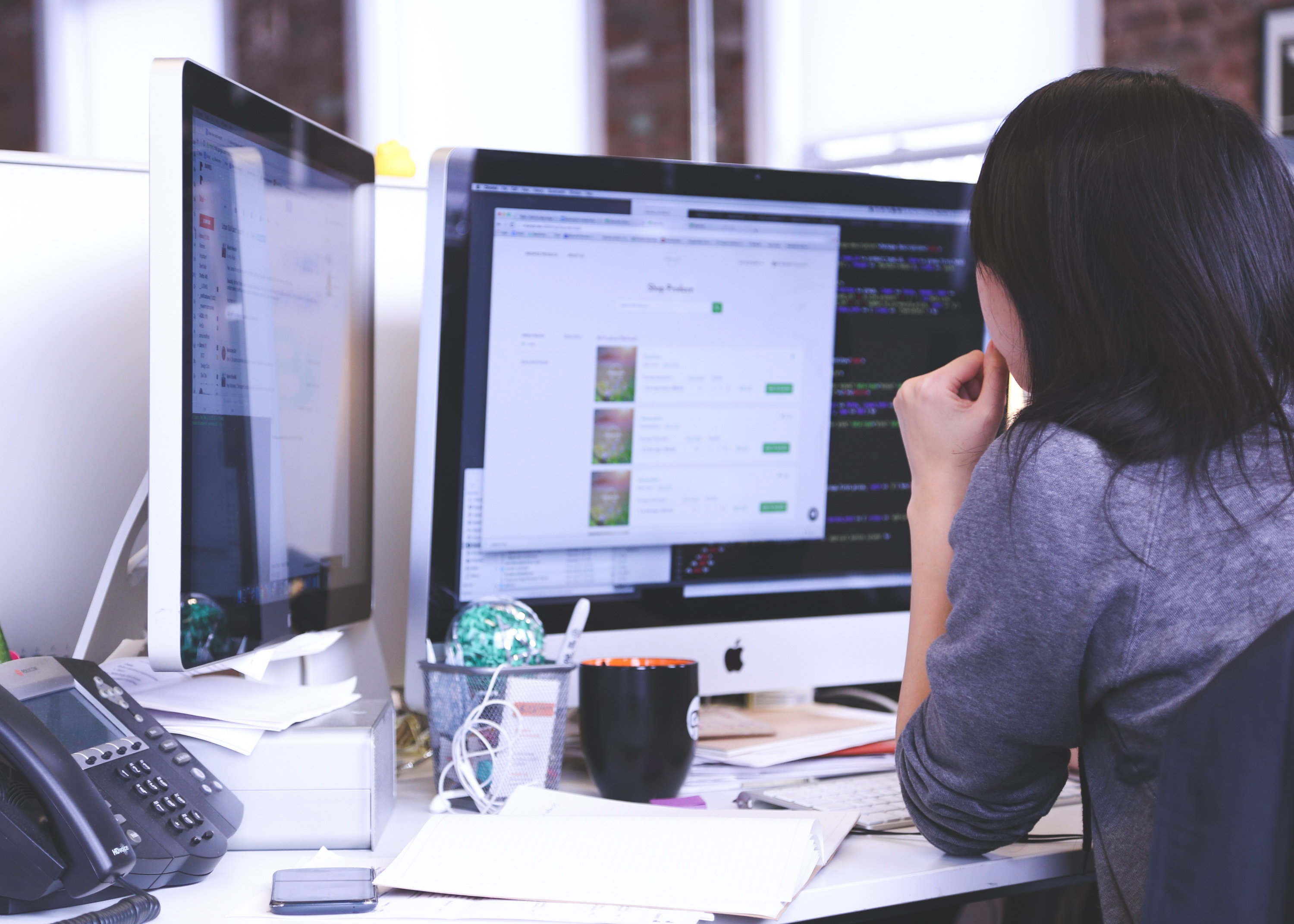 bookkeeper staring at a computer screen to illustrate article about software automation