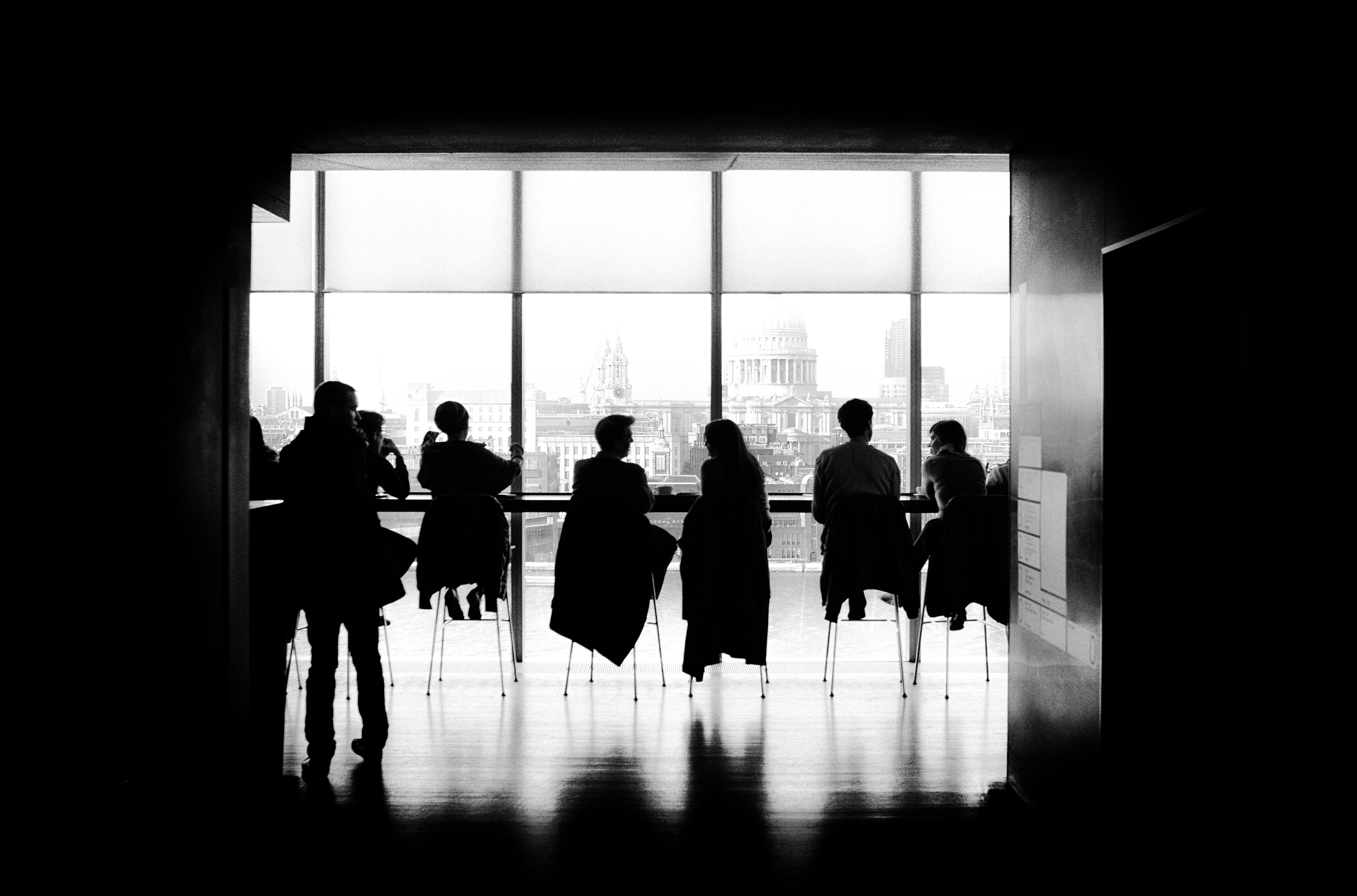 Photo of business executives at a long table illustrates post on financial reports for series A funding